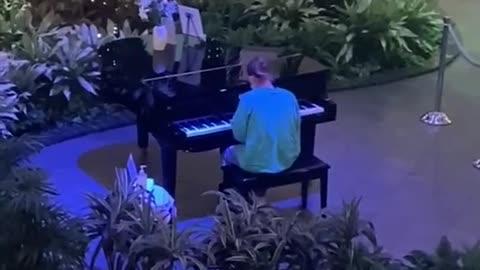 Nurse Plays Piano At Hospital