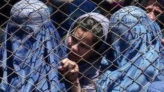 Some Afghan women defiant as Taliban return