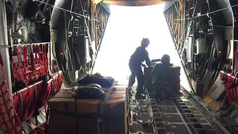 C-130 Parachute Pallet Drop (Slow-Mo)
