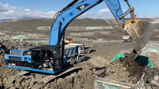 Hard Working Caterpillar 345C Excavator Loading Trucks