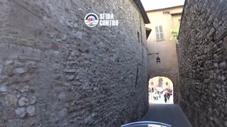 By motorcycle in the historic center of Assisi