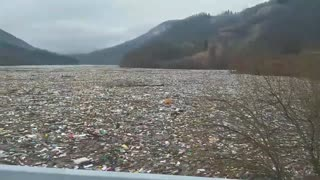 Flooded river completely fills up with garbage from landfill