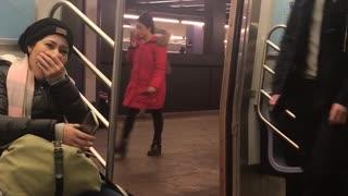 Shirtless man exercises and runs in place at a subway station