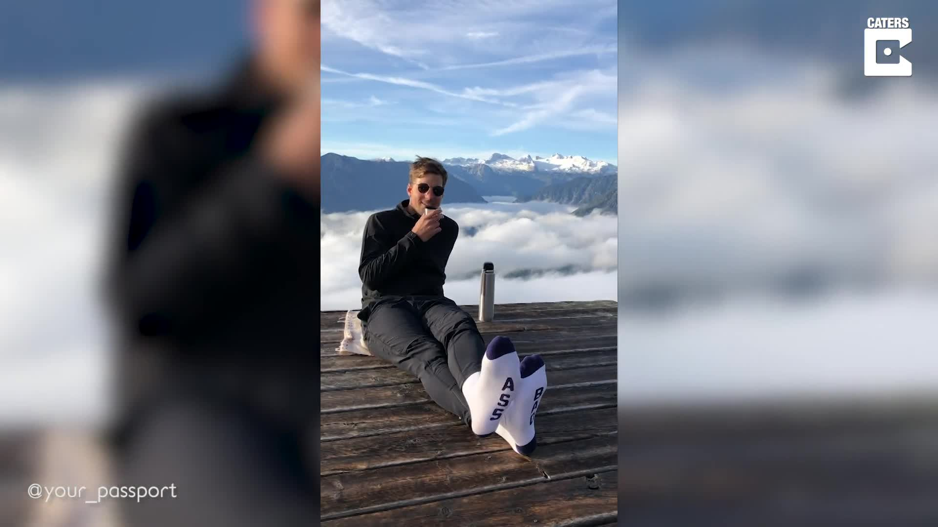 TEA FOR TWO: COUPLE SHARE CUP OF TEA IN CLOUDS WITH STUNNING VIEWS OF AUSTRIAN MOUNTAIN RANGE