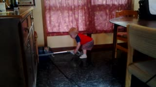 Toddler Bodhi vacuums the cottage to help out.