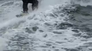 Guy water skiing in a suit