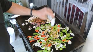 Cooking on a Blackstone griddle, Ground beef fajitas.