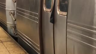 Clothing sticking out of subway train doors