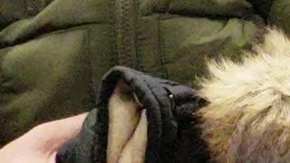 Man holds strange looking stuffed toy puppet, sleeps on subway train