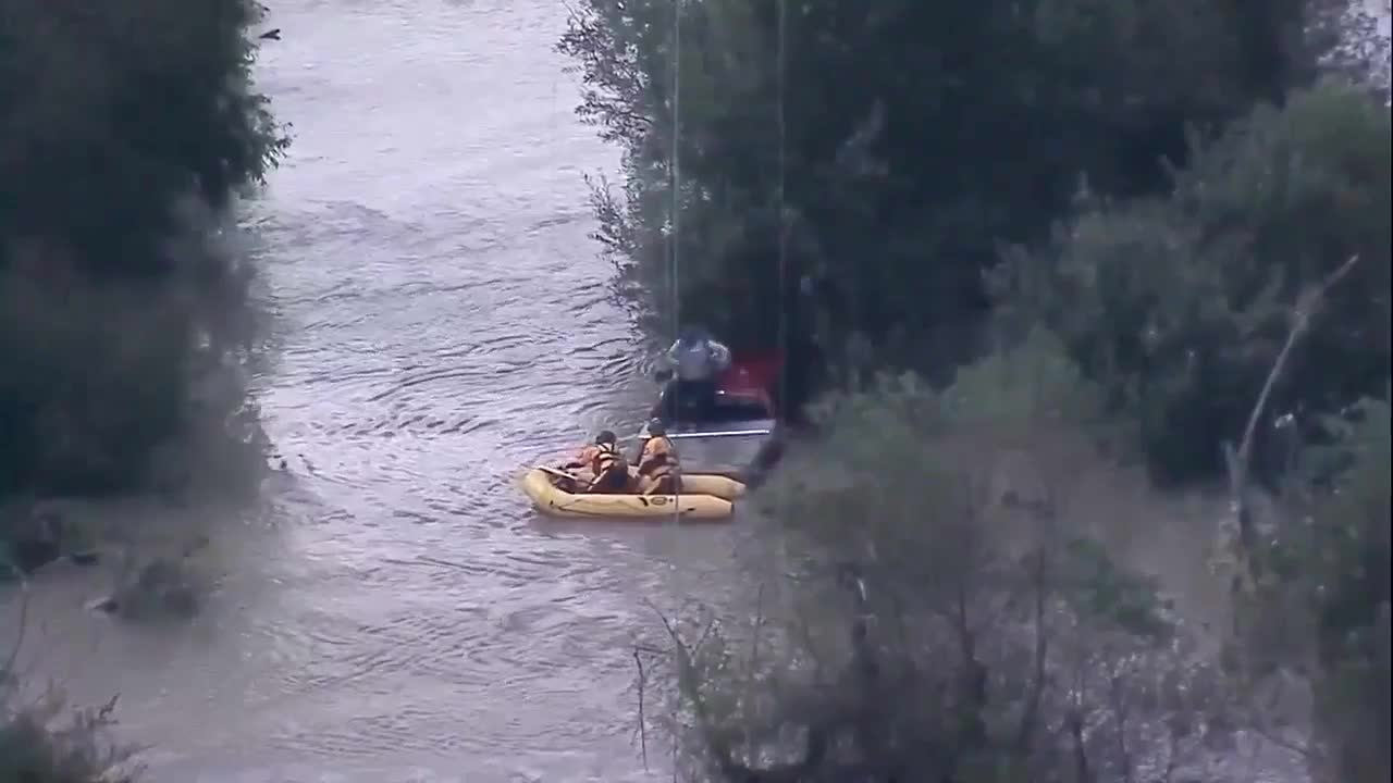 Trapped driver rescued from flood