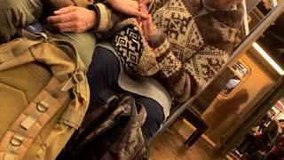 Woman filing old mans nails