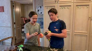 Kids hilariously peel apple with power drill