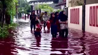 Red dye water floods Indonesian village