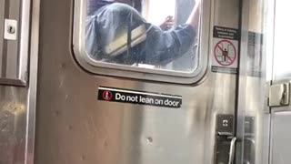 Guy wearing goggles face mask in between subway trains