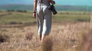 A Woman Taking Photos In The Wilderness