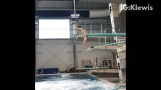 Guy does double front flip off diving board and belly flops into pool
