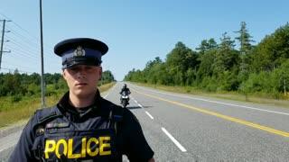 Officer hides motorcycle behind pen