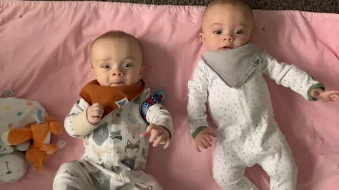Baby steals twin brother's pacifier right from his mouth