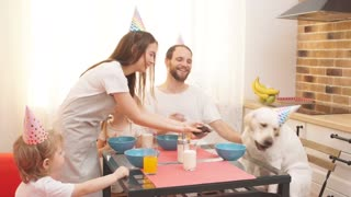 Whole family is enjoying birthday party for their dog