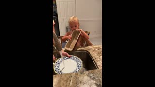 Toddler helping mommy with the dishes