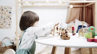 A Little Girl Playing With Wooden Toys