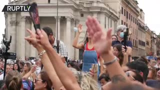 Thousands protest Draghi's health pass in Italy.
