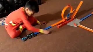 Oliver playing cars