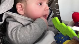 Stunned baby hilariously watches dad eat his food