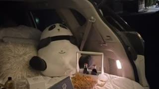 Outdoor night watching movies in car an sleeping