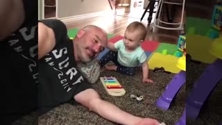 Funny baby falling down