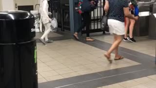 Small person kid dressed in all white subway station