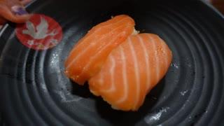 Slow motion shot of Salmon Sushi