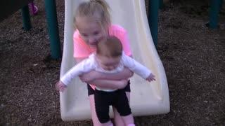 Big Sister takes Little Sister down the Slide
