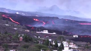 Lava streams past La Palma houses