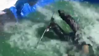 Skier tries to do a jump over pool, trips over ramp and falls into the water