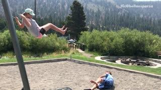 Boy in blue jumps off swing falls off
