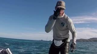 Man on boat in ocean gets hit by fishing pole