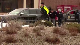 Colorado shooting reported; man seen in handcuffs