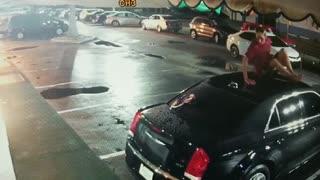 Floridian Caught Falling on Car