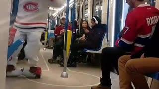 Man white hockey uniform on hover board on train