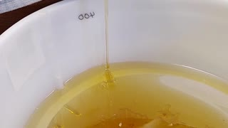Honey Pouring from Honey Extractor