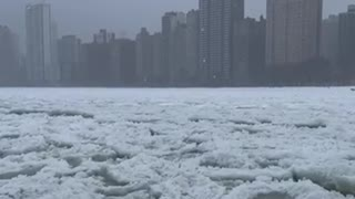 Chicago lake front nearly freezes over during winter storm