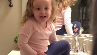 Little girl discovers she has eyebrows