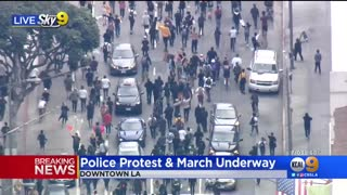 Police clash with protesters in downtown Los Angeles
