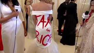 """AOC Paradoxically Wears a """"Tax the Rich"""" Dress to the Met Gala"""