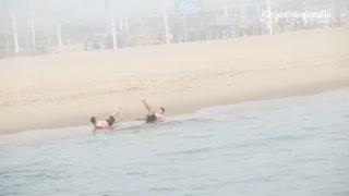 Two guys leg workout beach