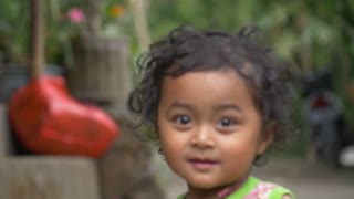 A very beautiful shot taken of a young balinese child
