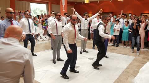 Husband And Groomsmen Deliver Surprise Performance For Bride