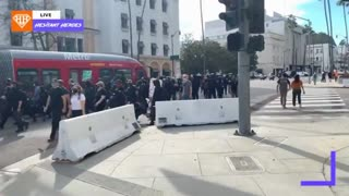 Beverly Hills. A gaggle of antifas. Imports.