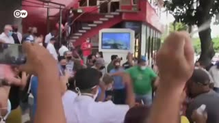 Cubans protest in the streets against Communist regime.